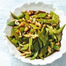 Snijbonen en cashewnoten uit de wok